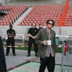 Josh Klinghoffer going onstage with coffee mug