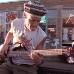 Flea wearing a woolly hat playing the bass