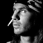 Chad Smith with a cigarette up his nose