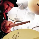 Chad Smith playing the drums in a top hat