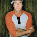 Chad Smith wearing an orange and grey top