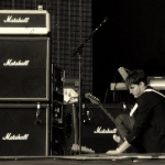 Josh Klinghoffer playing guitar black & white