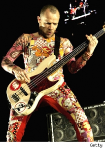 Flea slapping 1961 fender bass in shell pink with D Boon sticker