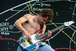 Flea playing Punk bass guitar with Circle Jerks logo
