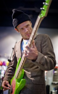 Flea playing green punk Fleabass Selfridges, London
