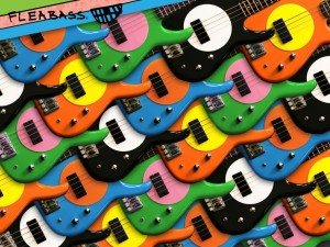 A group of Fleabass guitars sunny bass orange, water bass blue, the wild one black & white and punk bass green & orange