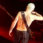 flea red hot chili peppers back tribal gap toothed tattoo