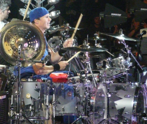 chad smith with RHCP transparent drum kit playing live